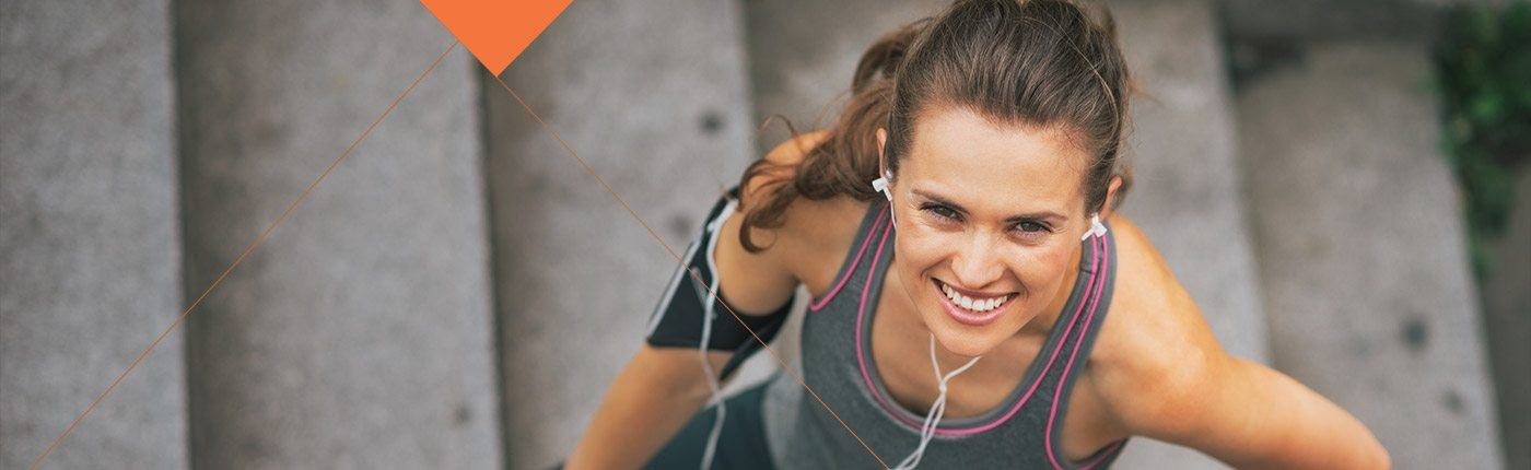 Smiling woman in exercise clothes
