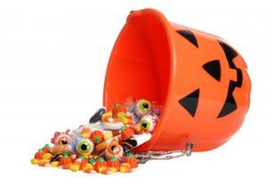 A Jack-o-Lantern bucket spilling candy.